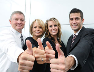 Coworkers giving a thumbs up